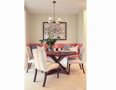 Designer: Brittany Stiles, Newport Beach interior designer, breakfast nook, built-in banquet bench seat dining table, built-in seat, Hickory Chair cabriole side chair, visual comfort chandelier, Peter Dunham artwork,