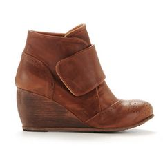 wedge boot. i kind of like these because i can actually walk in wedges!