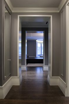 Since your hallway get a lot of light, you could get away with this darker shade. Designers Reveal Their Go-To Neutral Paint Colors: Chelsea Gray - Benjamin Moore Design Hall, Flur Design, Interior Desing, Interior Exterior, Interior Trim, Luxury Interior, Benjamin Moore Chelsea Gray, Baseboard Styles, Baseboard Trim