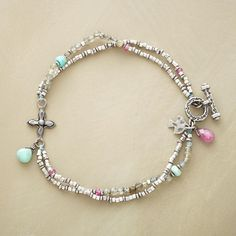 """CROSSROADS BRACELET--Two strands converge at a cross in a handcrafted exclusive featuring sterling silver with labradorite, turquoise and pink sapphire accents. Toggle clasp. 7-1/2""""L."""