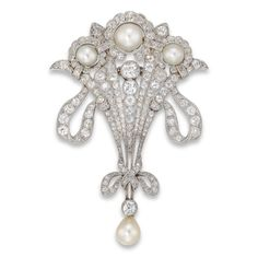 A fine Edwardian pearl and diamond ribbon brooch, the brooch in the form of a floral cluster bouquet with ribbon tie bow motif, set throughout with rose-, old- and old brilliant-cut diamonds, estimated to weigh a total of 3.20 carats, surmounted by three graduated natural pearls, measuring approximately 5 x 5 mm to 6.5 x 6.5 mm in diameter, all set to a platinum mount, with detachable platinum chain and detachable brooch fitting, gross weight 13.2 grams, circa 1910.