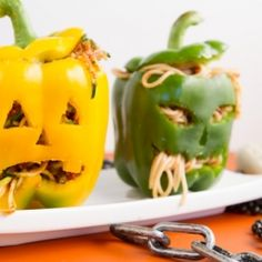 bell pepper jack-o-lanterns with raw red sauce and noodles. Gluten-free and vegan