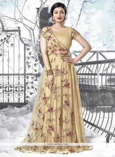 You are sure to make a strong fashion statement with this Ayesha Takia beige net designer floor length salwar suit. Beautified with resham and embroidered work all synchronized well with the pattern a. Designer Salwar Suits, Designer Anarkali, Designer Gowns, Indian Designer Wear, Designer Clothing, Anarkali Suits Online Shopping, Online Dress Shopping, Salwar Suits Online, Indian Gowns