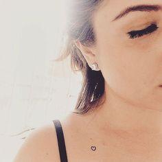 Tatuagem delicada de coração