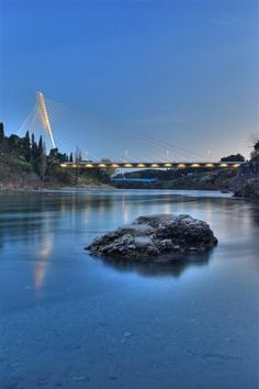Montenegro Adventures | Podgorica  Moraca river and Millenium Bridge in Podgorica after sunset by Vladimir Popovic Che