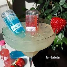 KINKY KUTIE MARGARITA  Ice shake Tequila Sour Lime Juice Triple Sec Insert 1.5 oz bottle of kinky red and blue.  Strawberry Garnish