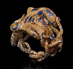 Jack du Rose Octopus yellow gold, yellow, orange and blue sapphire, cognac, champagne and white diamond, and black opal.