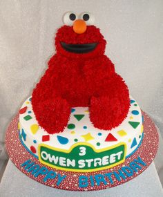 Elmo - Elmo made using the Wilton 3D bear cake pan. My family thought this was going to be a cake wreck but it actually came together once the hair was put on. Used the grass tip for hair and the mouth and nose are fondant. The eyes are ping pong balls.