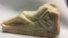 Marble figure. SHE GOT SLEEPY EYE'S.