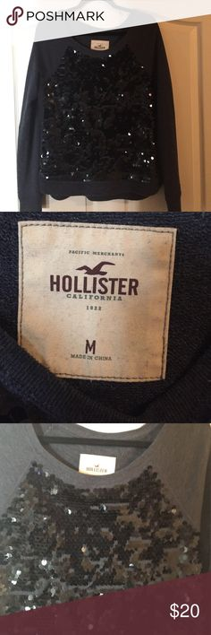 Hollister Sequin Sweater. Worn once... Hollister Sequin Sweater. Worn once... Great dressy comfortable with pant suit. Blackish grey color with black sequin. Not stretched and no missing sequin Hollister Sweaters Crew & Scoop Necks