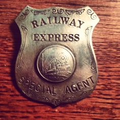 """This badge was worn by """"Special Agents"""" whose job was to ensure the safe delivery of goods shipped through the agency """"Railway Express Agency. Police Uniforms, Police Badges, Fire Badge, Law Enforcement Badges, Special Agent, Old Cameras, Antique Stores, Metal Signs, Patches"""