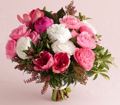 Peonies, garden roses, ranunculus and amaryllis make up this stunning pink wedding bouquet. [Flowers by Fleurs NYC]