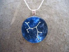 Sagittarius Jewelry - The constellation Sagittarius boldly contrasted against a starry blue night sky. 1 inch in diameter. Your eye-catching glass pendant starts as a crystal clear domed glass cabochon. Glass Tile Pendant, Resin Pendant, Glass Pendants, Pendant Jewelry, Pendant Necklace, Butterfly Jewelry, Pendant Design, Silver Necklaces, Unique Jewelry