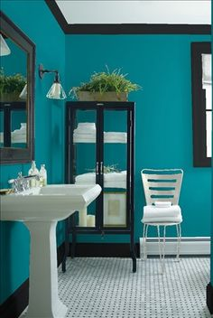 Look at the paint color combination I created with Benjamin Moore. Via @benjamin_moore. Wall: Caribbean Blue Water 2055-30; Trim: Black Satin 2131-10; Chair: Gray Horse 2140-50.
