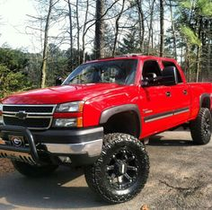 Red lifted Chevy Silverado truck