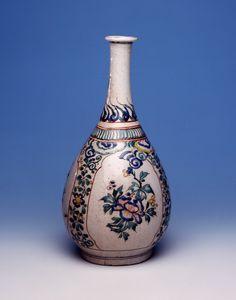 Bottle. Flowers. Made of blue underglaze and colours enamelled ceramic, porcelain.