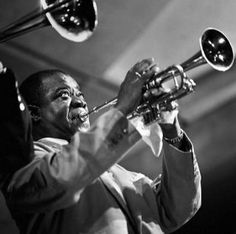 Louis Armstrong photographed by Herman Leonard.