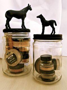 DIY-Dollar store plastic horses, glue, pickle jar, and spray paint. Makeup storage.