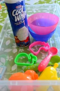 Edible Sensory activity for 1 year olds : Easter theme.  I would do this with yogurt instead of cool whip.