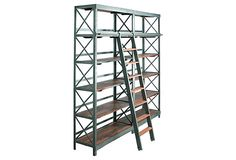 I've always wanted one of these sliding library ladders.