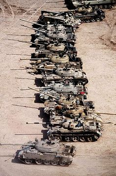 The Gulf War | Desert Storm ~ British troops guard captured Iraqi armor and weapons in the Kuwaiti desert. (Photographer: ©1991 Allan Tannenbaum)