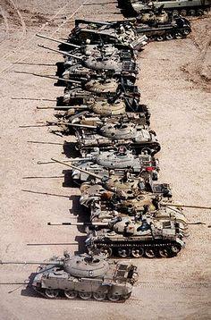 The Gulf War | Desert Storm ~ British troops guard captured Iraqi armor and weapons in the Kuwaiti desert. (Photographer: ©1991 Allan Tannenbaum)