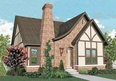 Charming 3-bedroom Tudor style home with well designed floor plan.  Tudor House Plan # 651127.