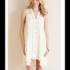 Ivory Button Down Dress w/Pockets Solid button down dress featuring pin tuck pleating detail, crochet paneling on the front and lace paneling on the shoulders and back of dress. Can easily be worn as dress or tunic! Non-sheer. Fully lined. Woven. Lightweight. Dresses Midi