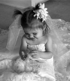 Photograph your daughter in your wedding dress then give it to her on her wedding day. For any of you with daughters...this is simply priceless;)