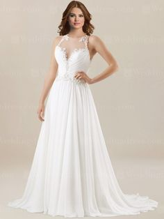 Beach style wedding dress is made in chiffon. Ruched bodice with illusion top is trimmed with lace appliques down to the drop waistline.