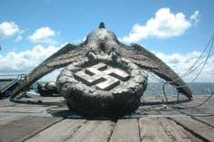 The huge bronze eagle and swastika, personally designed by Hitler, was salvaged by a British-led team from the stern of the pocket battleship Admiral Graf…