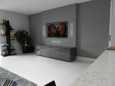 A recessed 65' TV, in-wall B&W 3 way speakers and the equipment seamlessly hidden inside the cabinet below. A minimalist touch to the living room perfect for get-togethers. #design #minimalism #livingroom