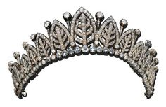 An early belle epoque diamond palmetta tiara. Designed as thirteen honeysuckle flowers enclosed in a diamond arch, with smaller spacers topped with circular diamonds, and rising from a base of circular diamonds. Sold by Chritie's in 1999.