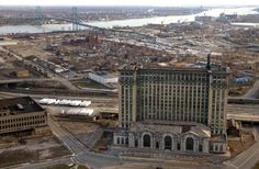 Detroit's abandoned Michigan Central Station.  Ambassador Bridge in the background.