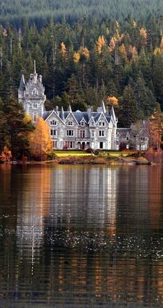 Ardverikie Castle or Lodge, Loch Laggan, Kingussie, Scottish Highlands, circa 1870. It was designed by John Rhind of Inverness in a Scots baronial style, its gabled roofline complete with octagonal turrets with corbelled conical roofs.