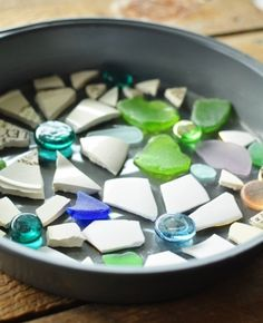 Making stepping stones out of broken dinnerware or glass stones, sea glass, anything your imagination conjures up. Use a round cake pan for the mold. Pour in concrete and allow to set up two days before popping out.