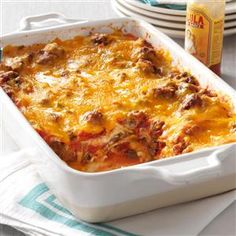 Beef Taco Lasagna Recipe -This recipe makes two big pans. Freeze one or both to enjoy later. —Stacey Compton, Toledo, Ohio