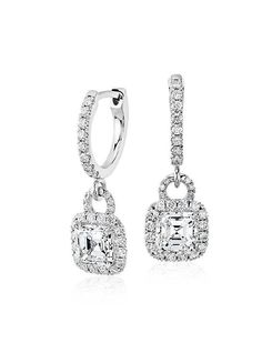 These drop earrings showcase Asscher-cut diamonds complemented by a diamond halo.