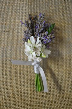 Barn wedding boutonniere with lavender and tweedia. Fleurish Floral Designs