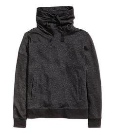 Cozy sweatshirt with a drawstring chimney collar, side pockets, and ribbing at cuffs and hem. Dark grey melange.   Warm in H&M