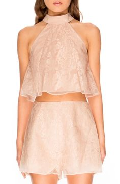 Crushing on the sheer overlay accented with intricate embroidery that sweetens this throwback-inspired halter top.