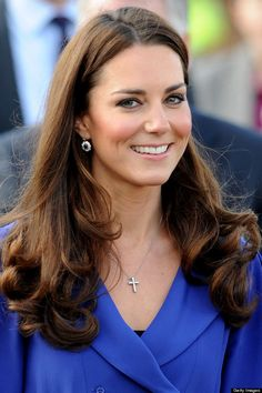 The Duchess of Cambridge wearing her Sapphire and Diamond earrings and cross pendant.