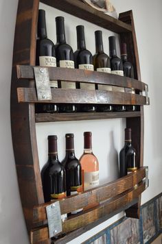 This is a unique wine bottle wine rack. The outline with the sides and the top are the exact dimensions of a full size barrel, 36 tall by about 28 wide. Sides are staves from the Napa wine barrel, and barn wood shelfs. Wine Rack Wall, Wine Glass Holder, Wine Wall, Whisky Regal, Wine Barrel Crafts, Barris, Barrel Projects, Wine Barrel Furniture, Rustic Wine Racks