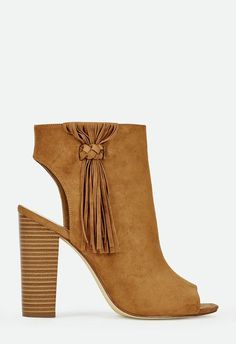 From office to out, these peep toe booties are truly versatile. Trendy fringe styling paired with a comfortable stacked heel, it's a match made in shoe heaven. Faux suede. ...