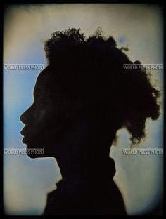 WPP, 2007, Chuck Close, 2nd prize, Portraits. Artist Kara Walker. Walker is known for her work dealing with African American history, largely during the period of slavery and the American civil war. She uses the 19th-century art-form of silhouette to graphically depict abuses of the time. The photographer employed daguerreotype, another process of the period, to reference and pay tribute to Walker's work.