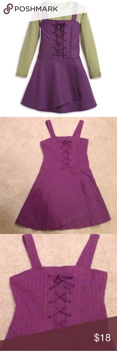 American Girl Jumper Dress Purple Plum Pin Stripe American Girl Jumper Dress Dark purple plum color Size 8 Lace up detail Pin striped In very good condition (Green Shirt Not Included)  Please ask any questions  💲Open To Offers💲 🚫No Trades🚫 📦Ask About Bundle Discounts💰 American Girl Dresses Casual