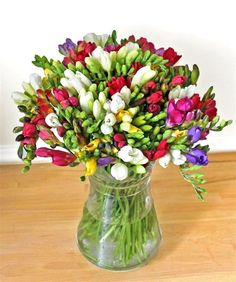 Lovely varied colors of fresia; casual centerpiece, farm wedding