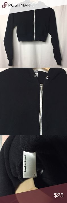 American apparel crop hoodie AA cropped zip up hoodie. Worn once or twice, no noticable signs of wear and in excellent condition. Size small but feels a little tight to me (but I have a fairly large bust) missing the drawstring but I have it and will put it back in before shipping American Apparel Tops Sweatshirts & Hoodies