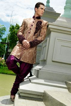 Rediscover your #style and sense of #fashion by wearing this latest #cream with golden colour #slimfit Indo-Western brocade sherwani. It's an ideal #wedding wear.
