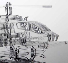 Helicopter model, Marine Cobra chopper, Miniature sculpture,Retirement gift, Replica, Air force military, Man gifts, office desk decor.  A transparent 3D laser cut acrylic glass model Bell AH-1 Cobra. This American attack helicopter has been used since the Vietnam War throughout the Granada Invasion, Operation Desert Storm until current days.  The edges are smooth and conduct light in a fantastic fiber optic style, which creates a spectacular crystalline sheen. All of its 48 parts were…